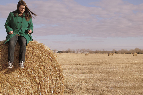 Jess on a bale of hay near Calgary Alberta