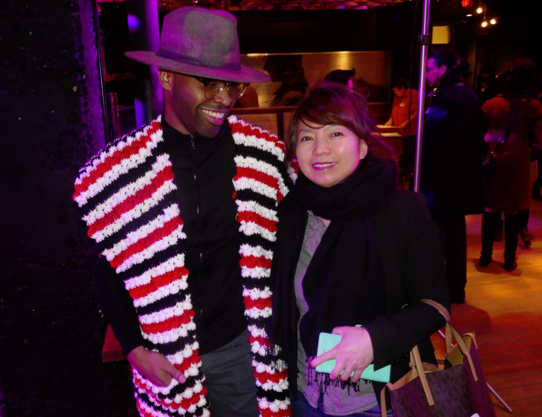 a colouful banker beside Lily Liao at Fashion Meets in Toronto