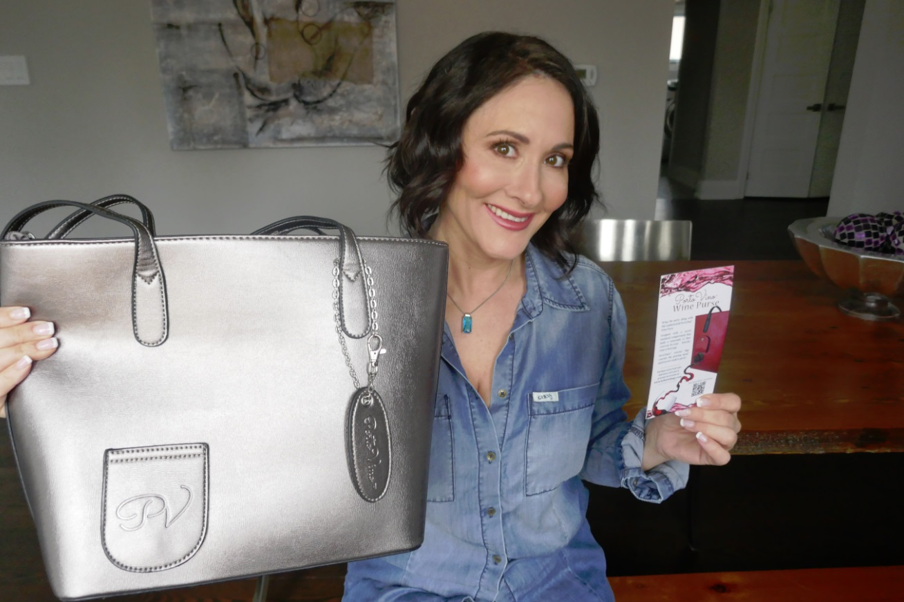 Laura Bilotta holds wine purse - a container for wine
